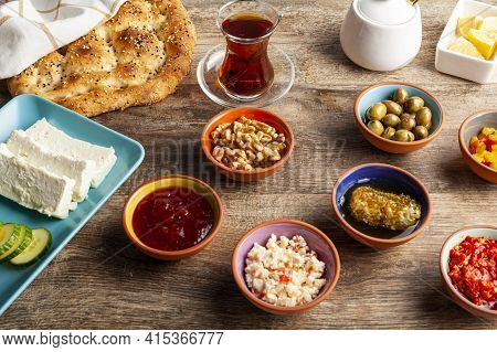 Healthy Turkish Breakfast, With Sliced Tomato, Cucumber, And White Feta Cheese, Small Bowls Of Straw