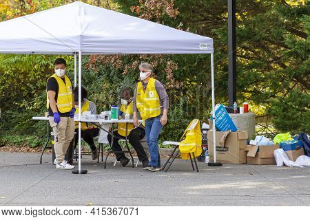 Rockville, Md, Usa 11-05-2020: Voluntary Front Line Personnel Working At A Drive Through Covid-19 Te