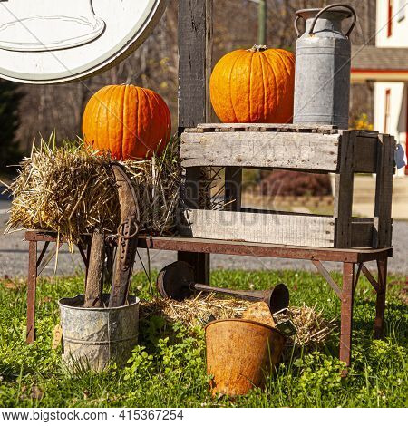Yard Decoration Featuring Straw Bales, Pumpkins, Old Household Objects (rusty Tools, Metal Pitchers