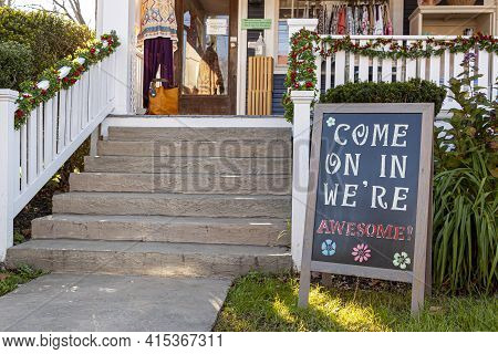 A Sandwich Board With A Welcoming Notice On It Which Reads :