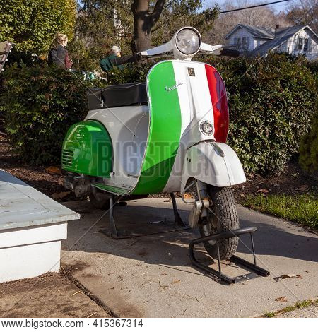 Clifton, Va, Usa 11-14-2020: A Vespa Scooter Motorbike Painted In The Striped Colors Of Italian Flag