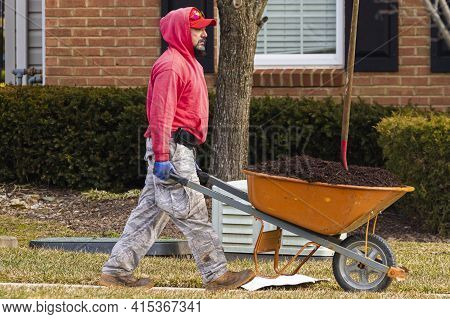 Clarksburg, Md, Usa 03-03-3021: A Latino Man With A Goatee Beard Wearing Red Hoodie, Camouflage Pant