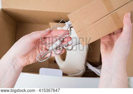 White Kitchen Mixer With Bowl Is Taken Out Of Box. Delivery Of Goods From Store