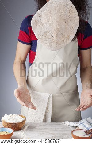 Preparation Of Homemadeturkish Flat Bread, Pide Or Pizza Base In The Kitchen. The Female Baker Is Th