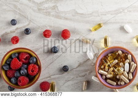 A Contrast Concept For Healthy Life. On One Side There Is A Bowl Of Fresh Fruits (berries) On Other