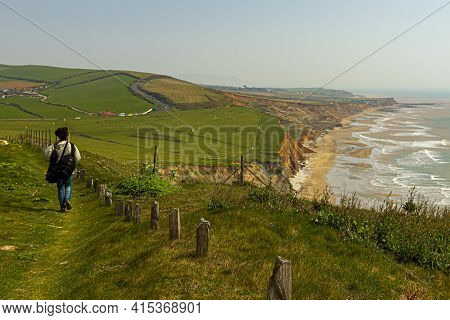 Idyllic Coast Of Isle Of Wight With Cliffs, Atlantic Ocean, Shoreline, Pastures And Farms At A Dista