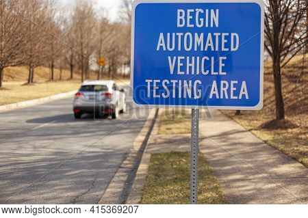 Close Up Isolated Image Of A Road Sign Near Washington Dc That Says: Begin Automated Vehicle Testing