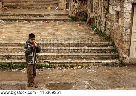 Tartus, Syria 03.27.2010: A School Aged Syrian Boy Is Playing Outside In A Low Income Neighborhood O