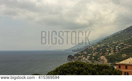 Hill Top View Of The Ligurian Coast Of Italy Between Genoa And Cinque Terra. There Are Houses On The