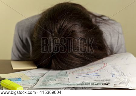 A Young Tired Woman Wearing Formal Dress Has Fallen A Sleep On Her Office Desk While Filling Federal