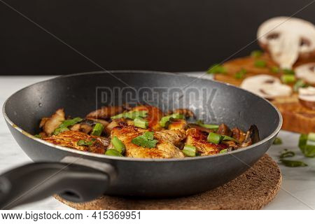 Side View Selective Focus Image Of Sauteed Roasted Chicken Breasts In A Non Stick Frying Pan On Whit