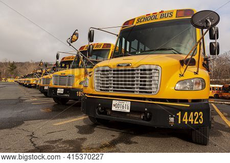 Bethesda, Md, Usa 12-21-2020: Close Up Selective Focus Frontal View Of A School Bus Fleet At A Parki