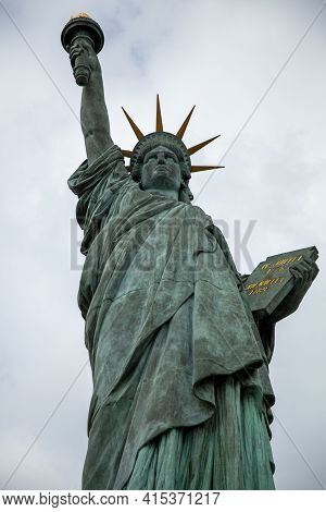 A Close Up Photo Of One Of The Oldest Replicas Of The Statue Of Liberty. This One Is Quarter The Siz