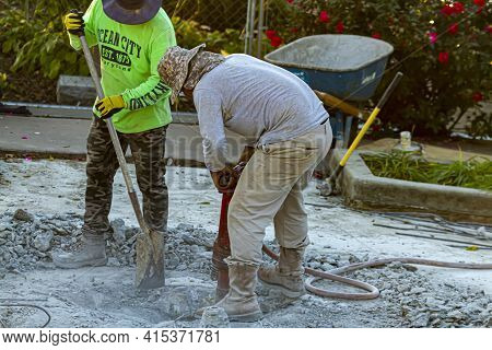 Frederick, Md, Usa 10/13/2020: Two Construction Workers Are Drilling The Concrete Floor Of A Section