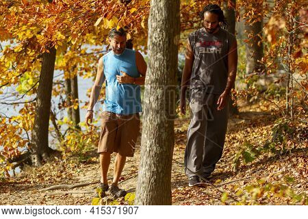 Boyd, Md, Usa 10/20/2020: A Young Athletic African American Man And His Caucasian Friend Are Walking