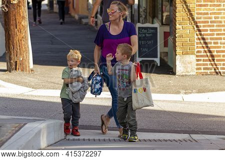 Ellicott City, Md Usa 10/07/2020: A Single Caucasian Mother With Two Little Boys Are Walking In The