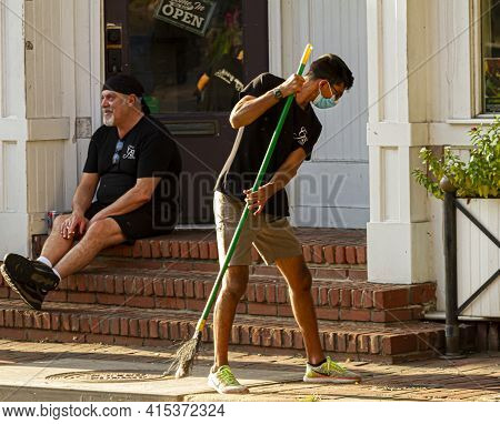 Ellicott City, Md, Usa 10/07/2020: A Young Hispanic Janitorial Worker Wearing Face Mask Due To Covid