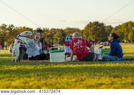 Arlington, Va, Usa 10/02/2020: A Multi Racial Group Of Young People Are Sitting On Foldable Chairs O
