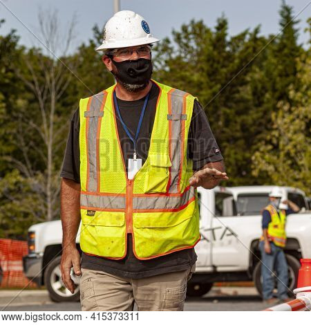 Bethesda, Md, Usa 09/15/2020: A Caucasian Construction Worker Wearing Safety Equipment Such As Goggl