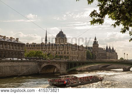 Paris, France, 06/13/2010: A Sunny Day In Paris. Photo Features The River Seine With A Sightseeing B