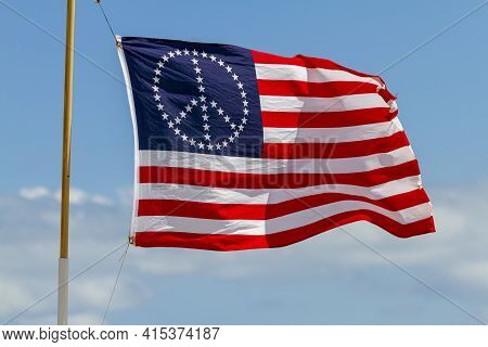 A Stars And Stripes United States Flag With The Stars Oriented In The Shape Of The Peace Sign. This