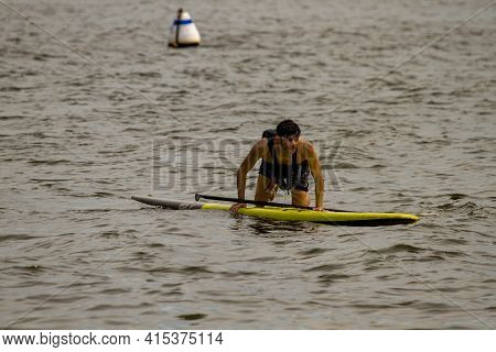 Annapolis, Md 08/21/2020: A Young Inexperienced Kayaker Is Trying To Climb Back Up To His Stand Up K