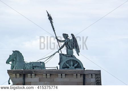 A Close Up View Of The Quadriga That Stands On Top Of The Iconic Brandenburg Gate In Berlin. The Sta