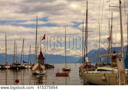 A Landscape View Of The Marina On The Coast Of Lake Geneva, Switzerland. Clear Waters Of The Lake, A