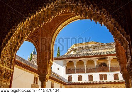 Granada, Spain 07/13/2010: View Of The Famous Alhambra Palace Through A Gate With Decorative Islamic