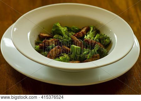 A Serving Of Seitan (wheat Gluten Based Meat Alternative) With Pan Fried Broccoli For A Vegan Diet.t