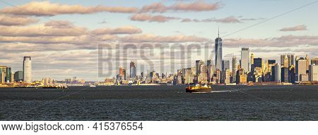 A Sunset Panorama Of Loweer Manhattan Skyline Featuring Ships, Skyscrapers, Upper Bay, Hudson River