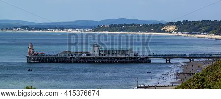 An Aerial Landscape Panoramic View Of The Bournemouth Pier On The Southern Coast Of England. There A