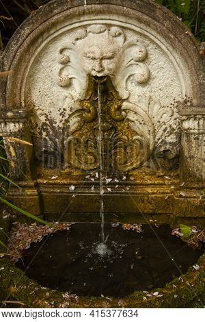 A Close Up Picture Of An Isolated Ancient Stone Fountain Which Has A Mythological Character Head Fig