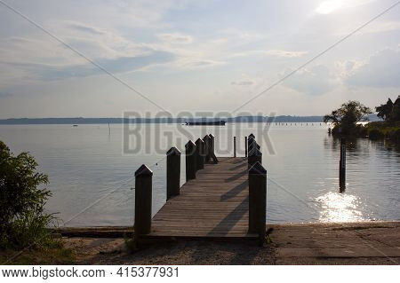 A View Of The Mallows Bay By Potomac River On A Sunny Day. Image Is Featuring A Boat Ramp And A Wood