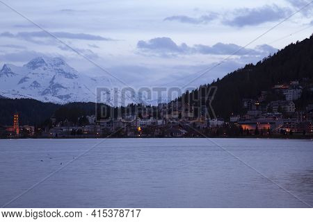A Night Time Panorama Of The High Alpine Upscale Resort Town Of St. Moritz, Switzerland. City Lights