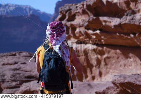 Close Up View Of A Westerner Tourist With Yellow Dreadlocks, Wearing Backpack, A Keffiyeh And A Slee