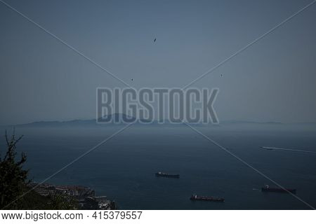 Aerial View Of The Strait Of Gibraltar  Taken On The Rock Of Gibraltar. Image Shows Hazy Horizon Wit