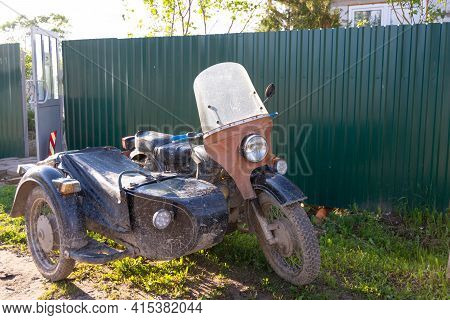 Russia - July 1, 2020. Tver Region, Russia. An Old Black Ural Motorcycle With A Sidecar Is Parked On