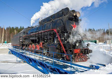 Ruskeala, Russia - August 26, 2021: Soviet Mainline Freight Steam Locomotive Lv-0522 On The Turntabl