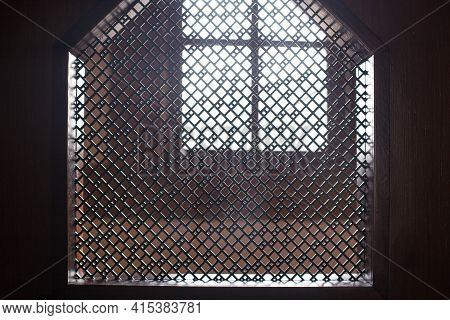 Old Priest Inside The Wooden Confessional In A Christian Church.