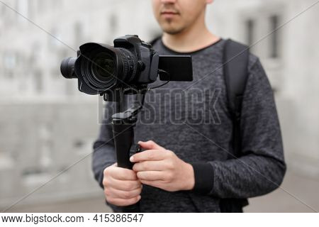 Videography, Filmmaking And Creativity Concept - Close Up Of Modern Dslr Camera On 3-axis Gimbal Sta