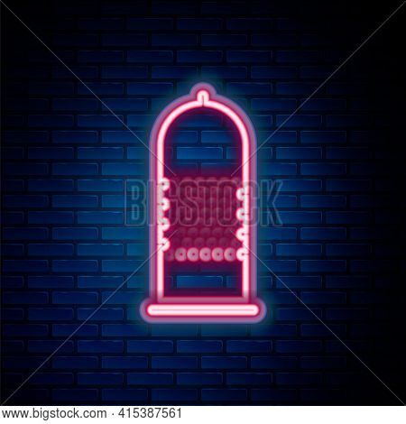 Glowing Neon Line Condom Safe Sex Icon Isolated On Brick Wall Background. Safe Love Symbol. Contrace