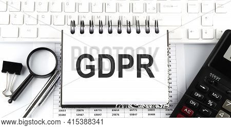 White Notebook With Text Gdpr On White Keyboard With Calculator,magnifier And Pen