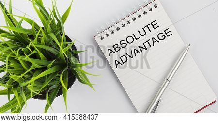 Keyword Absolute Advantage - Business Concept Text On White Notebook And Pen, Green Flowers