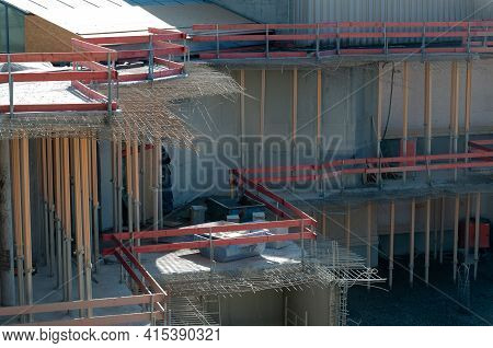 Reinforcement Steel Protruding Of Demolished Concrete Ceilings Supported By Steel Posts At A Constru