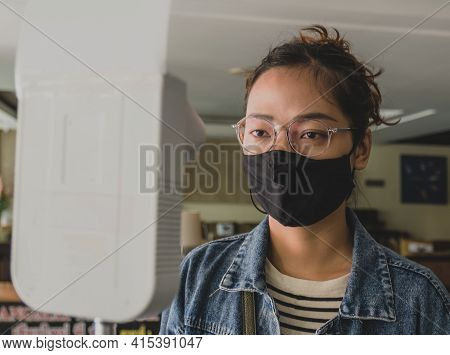 The Asian Tourist Woman Has Checked Body Temperature With A Thermal Temperature Scanner Detector Tra