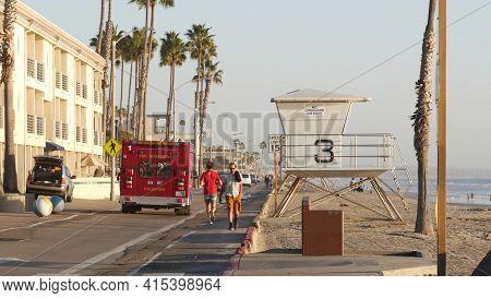 Oceanside, California Usa - 11 Feb 2020: Ems Emergency Medical Service Red Vehicle By Ocean Beach. F