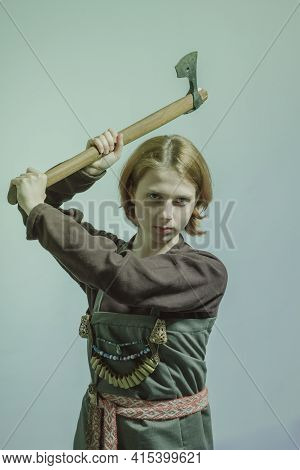 Brave Scandinavian Young Woman With Axe Posing Over Grey Background