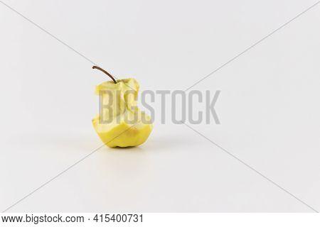 Golden Green Delicious Bitten Apple Isolated On White. An Apple Stub.