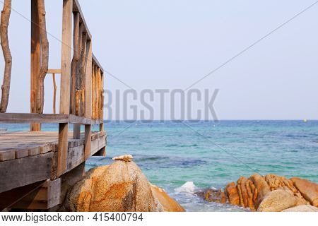 Wood Jetty And Beautiful Beach In Tropical Beach